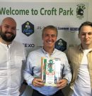 Hospitality package | Clark presents plaque to supporters